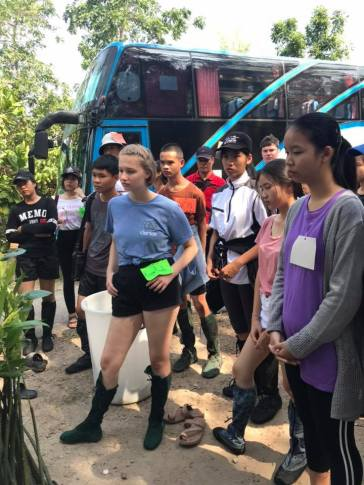 Receiving instructions on Mangrove planting.