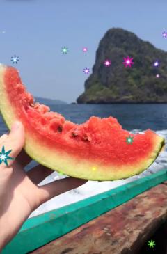 Enjoying some watermelon while on an island trip.